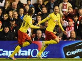 Matthew Connolly of Watford celebrates scoring their second goal with Odion Ighalo of Watford (R) during the Sky Bet Championship match between Nottingham Forest and Watford at City Ground on April 15, 2015