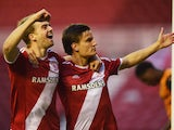 Jelle Vossen of Middlesbrough celebrates with Patrick Bamford as he scores their first goal during the Sky Bet Championship match between Middlesbrough and Wolverhampton Wanderers at Riverside Stadium on April 14, 2015