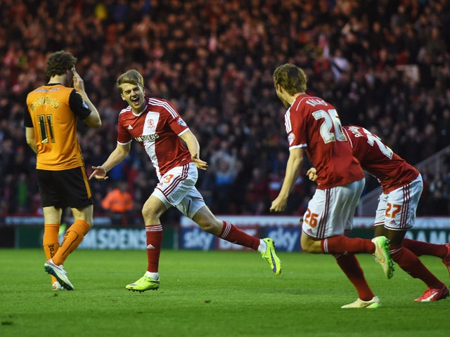 Patrick Bamford of Middlesbrough celebrates with team mates as he scores their second goal during the Sky Bet Championship match between Middlesbrough and Wolverhampton Wanderers at Riverside Stadium on April 14, 2015