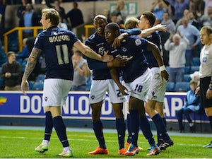 Magaye Gueye of Millwall FC celebrates scoring Millwall's 2nd goal during the Sky Bet Championship match between Millwall and Wigan Athletic at The Den on April 14, 2015