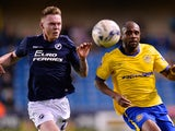 Aiden O'Brien of Millwall FC and Emmerson Boyce of Wigan Athletic during the Sky Bet Championship match between Millwall and Wigan Athletic at The Den on April 14, 2015