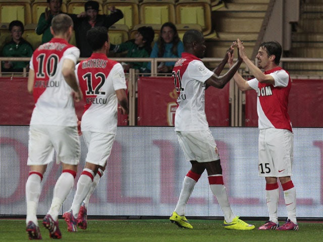 Monaco's Portuguese midfielder Silva Bernardo celebrates with teammates after scoring during the French L1 football match Monaco (ASM) vs Rennes (SRFC) at the Louis II Stadium in Monaco, on April 18, 2015