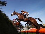 Oscar Time ridden by Sam Waley-Cohen in action during the 2015 Crabbie's Grand National at Aintree Racecourse on April 11, 2015