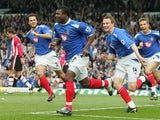 Yakubu of Portsmouth celebrates scoring from the penalty spot during the Barclays Premiership match between Portsmouth and Southampton at Fratton Park on April 24, 2005