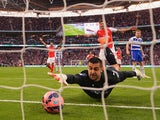 Adam Federici of Reading stretches for the ball as he fails to stop a shot by Alexis Sanchez of Arsenal for their second goal during the FA Cup Semi Final between Arsenal and Reading at Wembley Stadium on April 18, 2015