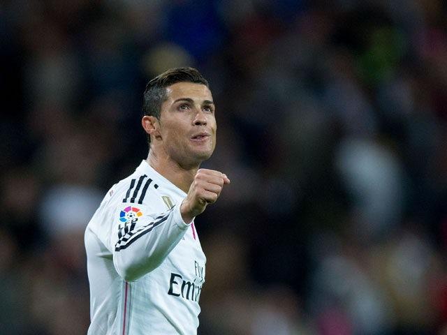 Cristiano Ronaldo of Real Madrid CF celebrates scoring their third goal during the La Liga match between Real Madrid CF and Malaga CF at Estadio Santiago Bernabeu on April 18, 2015