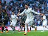 Sergio Ramos of Real Madrid CF celebrates scoring their opening goal during the La Liga match between Real Madrid CF and Malaga CF at Estadio Santiago Bernabeu on April 18, 2015