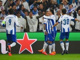 Ricardo Quaresma of FC Porto (3R) celebrates with team mates as he scores their second goal during the UEFA Champions League Quarter Final first leg match between FC Porto and FC Bayern Muenchen at Estadio do Dragao on April 15, 2015