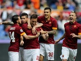 Francesco Totti #10 with his teammates of AS Roma celebrates after scoring the opening goal from penalty spot during the Serie A match between AS Roma and Atalanta BC at Stadio Olimpico on April 19, 2015