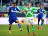 Schalke's defender Sead Kolasinac (L) vies with Wolfsburg's Belgian midfielder Kevin De Bruyne during the German first division Bundesliga football match VfL Wolfsburg vs FC Schalke 04 in Wolfsburg, central Germany, on April 19, 2015
