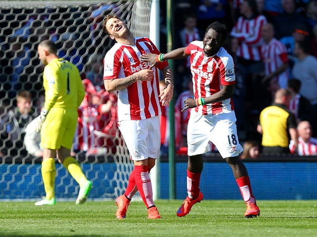 Mame Diouf of Stoke celebrates scoring his team's first goal during the Barclays Premier League match between Stoke City and Southampton at the Britannia Stadium on April 18, 2015
