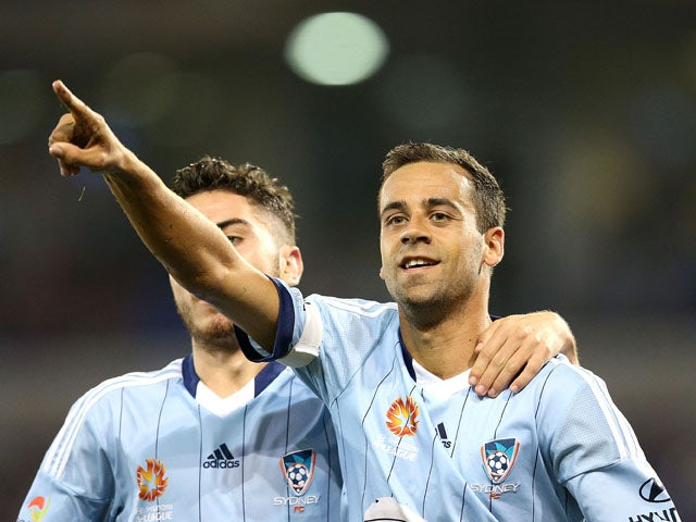Alex Brosque and Christopher Naumoff of Sydney FC celebrate a goal during the round 26 A-League match between the Newcastle Jets and the Sydney FC at Hunter Stadium on April 17, 2015
