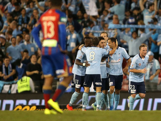Sydney FC players celebrate a goal during the round 26 A-League match between the Newcastle Jets and the Sydney FC at Hunter Stadium on April 17, 2015