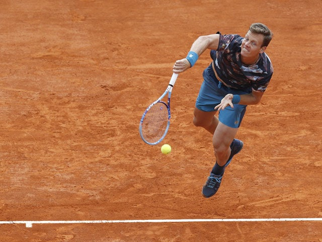 Czech tennisman Tomas Berdych serves to Canadian tennisman Milos Raonic during their quarterfinal match at the Monte-Carlo ATP Masters Series Tournament, on April 17, 2015