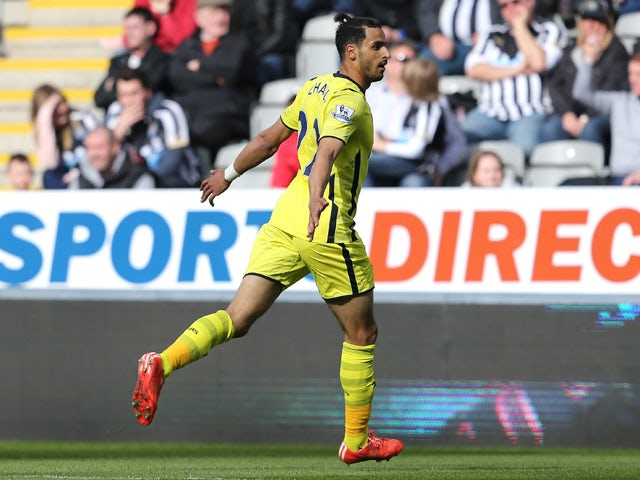 Nacer Chadli of Spurs celebrates scoring the opening goal during the Barclays Premier League match between Newcastle United and Tottenham Hotspur at St James' Park on April 19, 2015