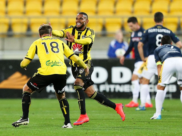 Kenny Cunningham of the Phoenix celebrates his goal with teammate Ben Sigmund during the round 26 A-League match between the Wellington Phoenix and the Central Coast Mariners at Westpac Stadium on April 17, 2015