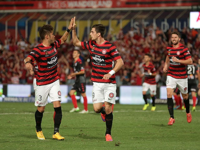 Tomi Juric of the Wanderers celebrates scoring a goal with team mates during the round 26 A-League match between the Western Sydney Wanderers and Adelaide United at Pirtek Stadium on April 18, 2015