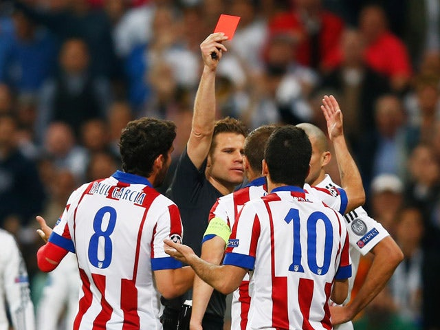 Arda Turan of Atletico Madrid (10) is sent off by referee Felix Brych during the UEFA Champions League quarter-final second leg match between Real Madrid CF and Club Atletico de Madrid at Bernabeu on April 22, 2015
