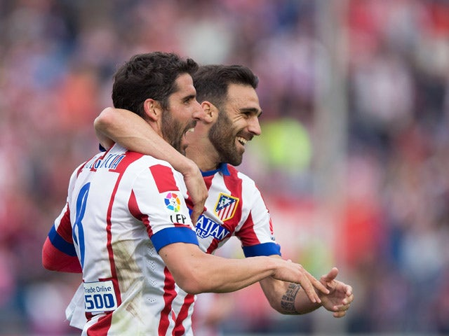 Raul Garcia of Atletico de Madrid celebrates scoring their second goal with team mate Jesus Gamez during the La Liga match between Club Atletico de Madrid and Elche FC at Vicente Calderon Stadium on April 25, 2015