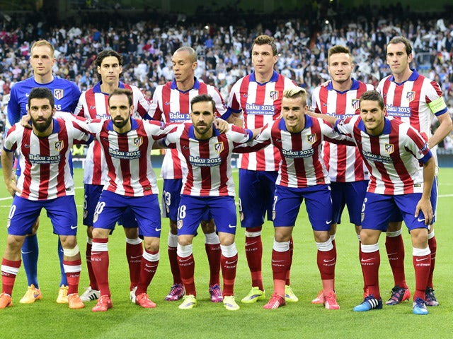 Atletico Madrid's players pose before the UEFA Champions League quarter-finals second leg football match Real Madrid CF vs Club Atletico de Madrid at the Santiago Bernabeu stadium in Madrid on April 22, 2015