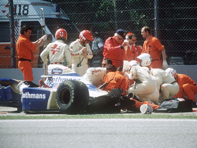Medical staff surrounds Brazilian Formula One driver Ayrton Senna after his crash during the San Marino Grand Prix on the Imola racetrack 01 May 1994
