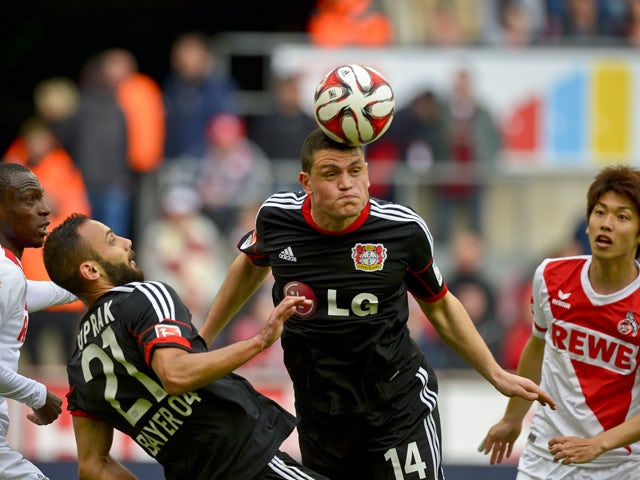 Leverkusen`s Kyriakos Papadopoulos heads the ball during the German first division Bundesliga football match between 1 FC Cologne v Bayer 04 Leverkusen in Cologne, Germany, on April 25, 2015
