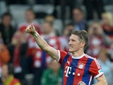 Bayern Munich's midfielder Bastian Schweinsteiger celebrates after the German first division Bundesliga football match between FC Bayern Munich and Hertha BSC Berlin at the Allianz Arena in Munich, southern Germany on April 25, 2015