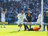 Youri Djorkaeff of Bolton celebrates his second goal during the FA Barclaycard Premiership match between Bolton Wanderers and Leeds United at The Reebok Stadium, on May 2, 2004