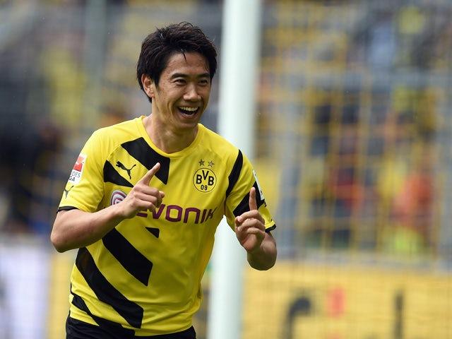 Dortmund's Japanese midfielder Shinji Kagawa celebrates during the German first division Bundesliga football match between BVB Borussia Dortmund v Eintracht Frankfurt in Dortmund, Germany, on April 25, 2015