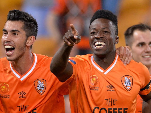 Kofi Danning of the Roar celebrates after scoring a goal during the round 27 A-League match between the Brisbane Roar and the Newcastle Jets at Suncorp Stadium on April 24, 2015