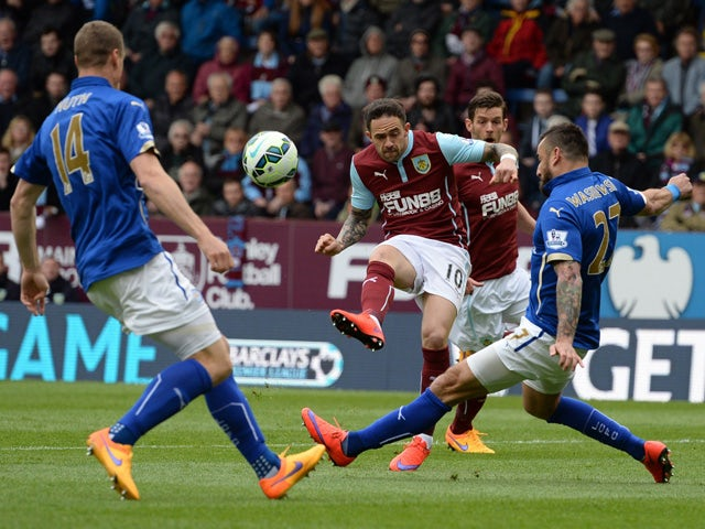 Burnley's English striker Danny Ings has a shot at goal blocked by Leicester City's Polish defender Marcin Wasilewski during the English Premier League football match between Burnley and Leicester at Turf Moor in Burnley, north west England on April 25, 2