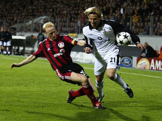 Carsten Ramelow of Bayer Leverkusen tackles Diego Forlan of Manchester United during the UEFA Champions League semi-final second leg match played at the BayArena, in Leverkusen, Germany on April 30, 2002