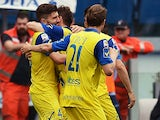 Chievo's forward Alberto Paloschi celebrates with his teammates during the Italian Serie A football match Lazio vs Chievo on April 26, 2015