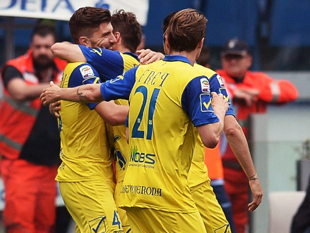 Chievo's forward Alberto Paloschi celebrates with his teammates during the Italian Serie A football match Lazio vs Chievo on April 26, 2015