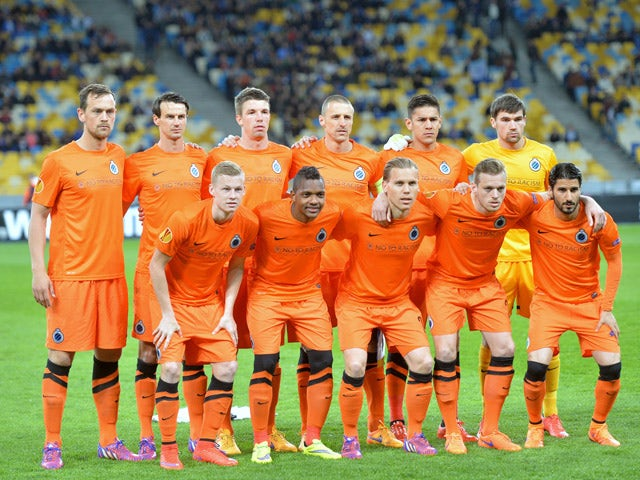 Club Brugge's players pose for a photo prior to the UEFA Europa League second leg quarter-final football match between FC Dnipro Dnipropetrovsk and Club Brugge KV in Kiev on April 23, 2015