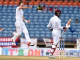 England's bowler James Anderson leaps into the air to celebrate dismissing West Indies batsman Marlon Samuels during the final day of the second Test cricket match between the West Indies and England at the Grenada National Cricket Stadium in Saint George