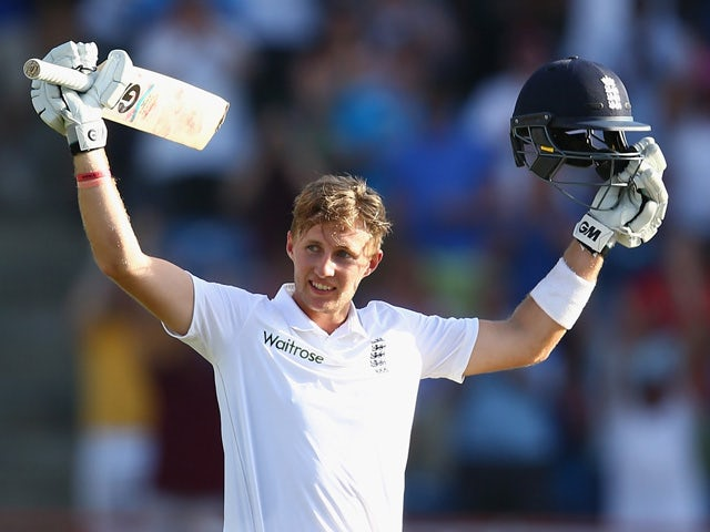 Joe Root of England celebrates reaching his century during day three of the 2nd Test match between West Indies and England at the National Cricket Stadium in St George's on April 23, 2015