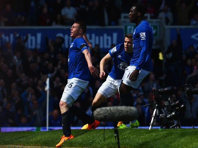 James McCarthy of Everton (16) celebrates with Seamus Coleman and Romelu Lukaku as he scores their first goal during the Barclays Premier League match between Everton and Manchester United at Goodison Park on April 26, 2015