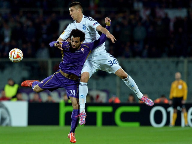 Dynamo Kiev's defender Yevhen Khacheridi vies with Fiorentina's Egyptian midfielder Mohamed Salah during the UEFA Europa League football match between Fiorentina and FC Dynamo Kiev at the Artemio Franchi Stadium in Florence on April 23, 2015