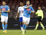 Napoli's French-Argentinian forward Gonzalo Higuain (R) celebrates after scoring a goal during the Italian Serie A football match between SSC Napoli and UC Sampdoria on April 26, 2015