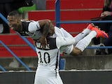 Guingamp's French midfielder Claudio Beauvue is congratulated by a teammate after scoring a goal during the French L1 football match between Caen and Guingamp on April 25, 2015