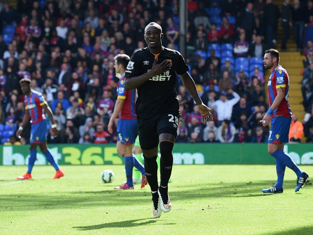 Dame N'Doye of Hull City celebrates scoring the opening goal during the Barclays Premier League match between Crystal Palace and Hull City at Selhurst Park on April 25, 2015