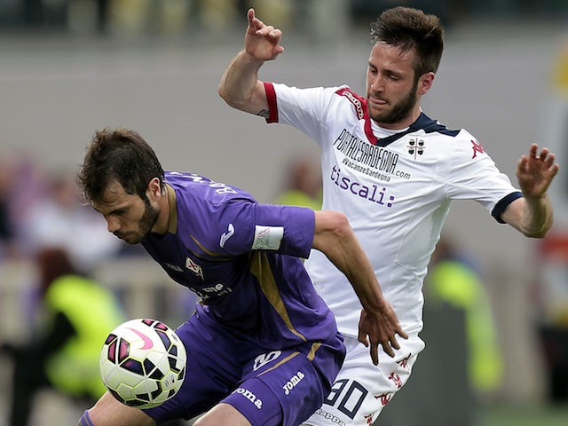 Jose' Maria Basanta of ACF Fiorentina battles for the ball with Duje Cop of Cagliari Calcio during the Serie A match between ACF Fiorentina and Cagliari Calcio at Stadio Artemio Franchi on April 26, 2015