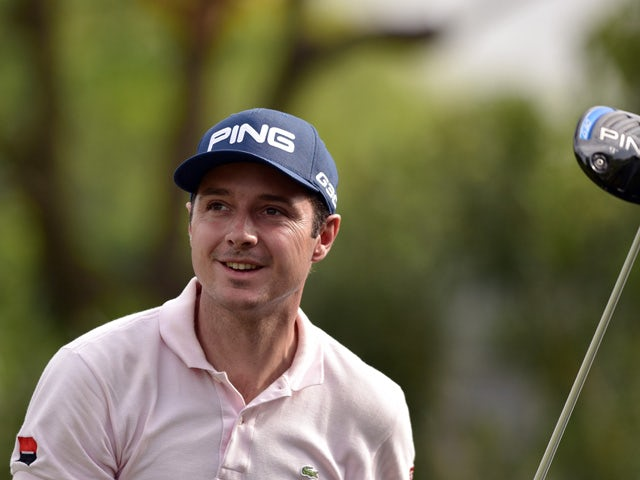 Julien Quesne of France tees off during the second round of the Volvo China Open golf tournament in Shanghai on April 24, 2015