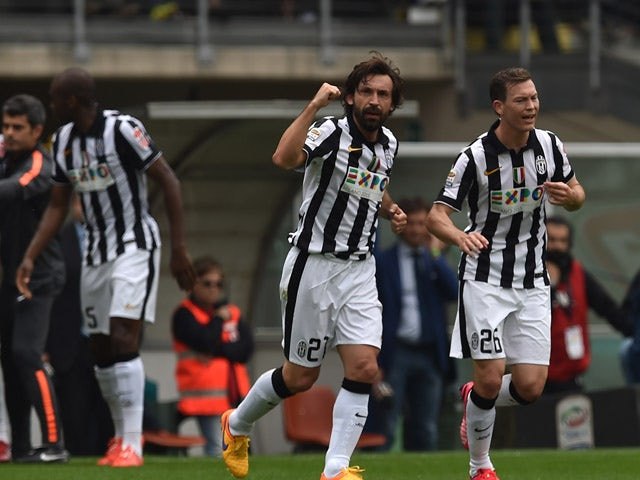 Andrea Pirlo of Juventus FC celebrates the opening goal during the Serie A match between Torino FC and Juventus FC at Stadio Olimpico di Torino on April 26, 2015
