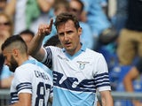 Miroslav Klose of SS Lazio celebrates after scoring the opening goal during the Serie A match between SS Lazio and AC Chievo Verona at Stadio Olimpico on April 26, 2015