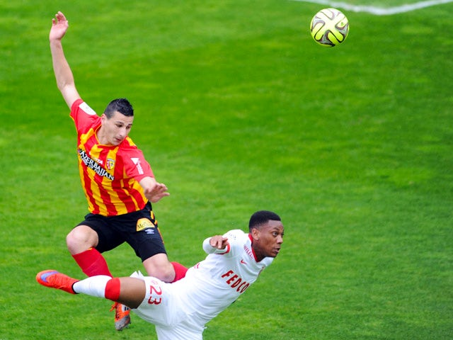 Lens' French forward Yoann Touzghar vies with Monaco's French forward Anthony Martial during the French L1 football match between Lens and Monaco at Licorne stadium in Amiens, northern France, on April 26, 2015