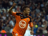Lorient's forward Jordan Ayew celebrates after scoring a goal during the French L1 football match between Marseille and Lorient on April 24, 2015