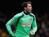Fulham goalkeeper Marcus Bettinelli in action during the Sky Bet Championship match between Fulham and Ipswich Town at Craven Cottage on February 14, 2015