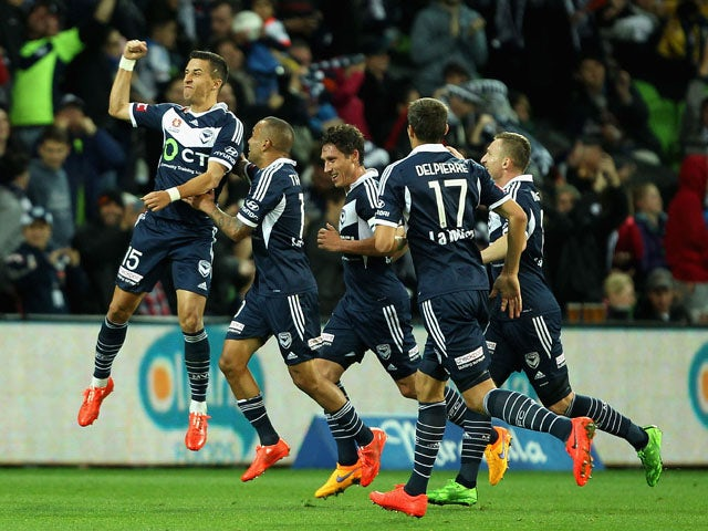 Daniel Georgievski of Melbourne celebrates with team-mates after scoring a goal during the round 27 A-League match between the Melbourne Victory and Central Coast Mariners at AAMI Park on April 26, 2015